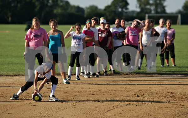 Beck Diefenbach  -  bdiefenbach@daily-chronicle.com<br /> <br /> Isabel Dobbel (far left) fields a ground ball during tryouts for a new travel fastpitch softball team called Sycamore Flash, at the Sycamore High School softball field in Sycamore, Ill., on Wednesday July 28, 2010.