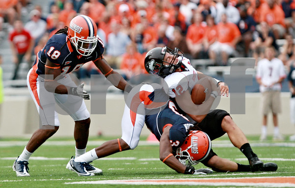 Rob Winner – rwinner@daily-chronicle.com<br /> <br /> Northern Illinois quarterback Chandler Harnish is hit in the back by Illinois defensive back Tavon Wilson in the first half during their game in Champaign, Ill.  on Saturday September 18, 2010.