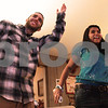 Kyle Bursaw – kbursaw@daily-chronicle.com<br /> <br /> Kevin and Pooja Ballantine show off their moves to the tune of Ke$ha's 'Tik Tok' while playing 'Just Dance 2' for Wii in front of family and friends who were celebrating Pooja's 18th birthday on Tuesday, Dec. 28, 2010.