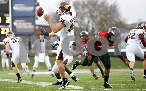 Rob Winner – rwinner@daily-chronicle.com<br /> <br /> Central Michigan kicker Brett Hartmann has his punt blocked by Northern Illinois' Jimmie Ward (15) during the fourth quarter in DeKalb, Ill. on Saturday October 23, 2010. DeKalb went on to defeat Central Michigan, 33-7.