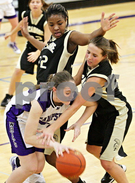 Beck Diefenbach  -  bdiefenbach@daily-chronicle.com<br /> <br /> Sycamore's Montia Johnson (32, top) and Ashley Berlinski (20, right) try to stop Hampshire's Christina Heine (30) during the fourth quarter of the IHSA Class 3A Regional game at Rochelle Township High School in Rochelle, Ill., on Wednesday Feb. 17, 2010