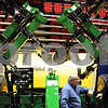 Beck Diefenbach  -  bdiefenbach@daily-chronicle.com<br /> <br /> John Emerson (far right), of Genoa, talks with Dennis Bauer, of Peabody's North, in front of a liquid fertilizer applicator at the Northern Illinois Farm Show at the Northern Illinois University Convocation Center in DeKalb, Ill., on Wednesday Jan. 6, 2009.