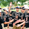Beck Diefenbach  -  bdiefenbach@daily-chronicle.com<br /> <br /> DeKalb's Frank Petras, center, and the rest of the state runner-up baseball team are introduced before the DeKalb County Liners game at Sycamore Park in Sycamore, Ill., on Monday June 28, 2010.