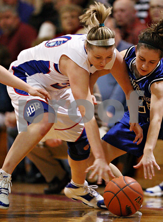 Beck Diefenbach – bdiefenbach@daily-chronicle.com<br /> <br /> Hinckley-Big Rock's Jenna Thorp (left) takes a loose ball from Westminster's Ellie Fink (25) during the first quarter of the IHSA Class 1A Regional playoff game at Indian Creek High School in Shabbona, Ill., on Wednesday Feb. 10, 2010.