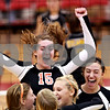 Beck Diefenbach – bdiefenbach@daily-chronicle.com<br /> <br /> DeKalb's Emily Bemis (15, top) celebrates after her team defeats Sycamore 2 to 1 at Victor E. Court in the Convocation Center on the campus of Northern Illinois University in DeKalb, Ill., on Tuesday Sept. 14, 2010.