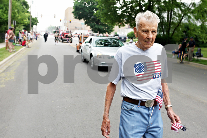 Rob Winner – rwinner@daily-chronicle.com<br /> <br /> World War II veteran Cully Wallin, of Sycamore, walks to the Ellwood House during the Memorial Day parade on Monday May 31, 2010 in DeKalb, Ill.