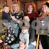 Kyle Bursaw – kbursaw@daily-chronicle.com<br /> <br /> Matt Morris' family will miss being with him this holiday season as he is off serving as a Marine in Afghanistan. Back row from left: Morris' son Wyatt, sister Megan Bacon, mother Leann Dunlap, sister Crystl Lindgren. Front, wife Jackie and son Cole. <br /> <br /> Taken in Kingston, Ill on Thursday, Dec. 23, 2010