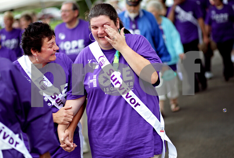 "Beck Diefenbach  -  bdiefenbach@daily-chronicle.com<br /> <br /> New friends, and cancer survivors, Kimberle Hall, center, of Rochelle, and Cindy Lakatos, left, hold hands as they they kick-off Relay for Life at Sycamore Park in Sycamore, Ill., on Friday June 18, 2010. ""You don't mind if I hold you hand do you?"" asked Lakatos. ""Its okay, I'm shaking."" replied Hall."
