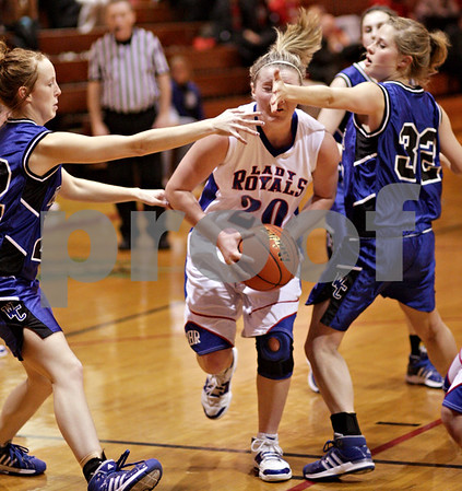 Beck Diefenbach – bdiefenbach@daily-chronicle.com<br /> <br /> Westminster's Hannah Graves (22, left) and Katie Moeller (32, right) attempt to stop Hinckley-Big Rock's Jenna Thorp (center) during the second quarter of the IHSA Class 1A Regional playoff game at Indian Creek High School in Shabbona, Ill., on Wednesday Feb. 10, 2010.