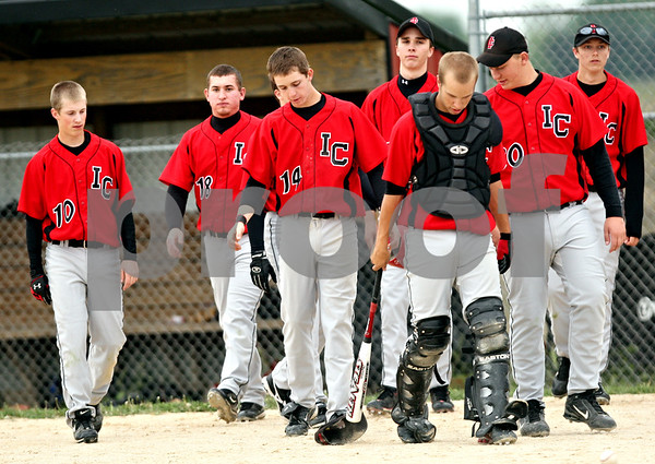 Beck Diefenbach  -  bdiefenbach@daily-chronicle.com<br /> <br /> Eliminated from post-season play, the Indian Creek baseball team walks back to the dugout after losing to Fulton 6 to 4 at Indian Creek High School in Shabbona, Ill., on Monday May 17, 2010.
