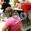 Beck Diefenbach – bdiefenbach@daily-chronicle.com<br /> <br /> Seventh grade math teacher Brant Boyer works with a student during class at Clinton Rosette Middle School in DeKalb, Ill., on Wednesday Sept. 15, 2010. To help reduce bullying, teachers are asked to watch for changes in physical and emotional well being.