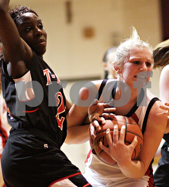 Beck Diefenbach – bdiefenbach@daily-chronicle.com<br /> <br /> Indian Creek's Michelle Crayton (left) and Amboy's Courtney Olson (23) get tangled up while fighting for the ball during the second quarter of the IHSA Class 1A Regional playoff game at Indian Creek High School in Shabbona, Ill., on Wednesday Feb. 10, 2010.