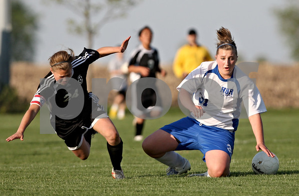 Rob Winner – rwinner@daily-chronicle.com<br /> <br /> Kaneland's Emily Heimerdinger (left) and Hinckley-Big Rock's Bridgette Edmeier go to the ground after colliding for a ball during the first half of their game in Hinckley, Ill. on Wednesday April 28, 2010.