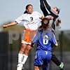Beck Diefenbach  -  bdiefenbach@daily-chronicle.com<br /> <br /> DeKalb's Jassmine Marquez (3, left) leaps to head the ball as Burlington Central goal keeper Caitlin Solberg stop the ball during the first half of the game at Rochelle Township High School in Rochelle, Ill., on Tuesday May 18, 2010. DeKalb defeated Burlington Central 4 to 2.