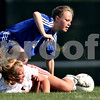 Beck Diefenbach  -  bdiefenbach@daily-chronicle.com<br /> <br /> DeKalb's Cara Sisler (4, bottom) and Burlington Central's Michelle Fowler (3) try to get up after colliding during the second half of the game at Rochelle Township High School in Rochelle, Ill., on Tuesday May 18, 2010. DeKalb defeated Burlington Central 4 to 2.