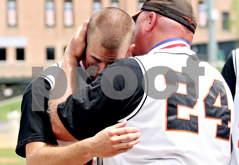 Rob Winner – rwinner@daily-chronicle.com<br /> <br /> DeKalb's Frank Petras (left) hugs his coach Justin Keck at the end of the IHSA Class 3A championship in Joliet, Ill. on Saturday June 12, 2010. Chatham Glenwood defeated DeKalb, 11-1, in six innings.
