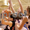 Beck Diefenbach  -  bdiefenbach@daily-chronicle.com<br /> <br /> Indian Creek's Anna Stiker (10, left) holds onto a rebound as Hinckley-Big Rock's Alyssa Baunach (23) defends during the second half of the Little 10 Tournament semi-final game at H-BR in Hinckley, Ill., on Thursday Jan. 21, 2010.  H-BR defeated Indian Creek 69 to 34.