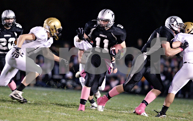 Rob Winner – rwinner@daily-chronicle.com<br /> <br /> Kaneland's Taylor Andrews carries the ball during the first quarter in Maple Park, Ill. on Friday October 15, 2010.