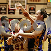 Rob Winner – rwinner@daily-chronicle.com<br /> <br /> Indian Creek's Gretchen Tyler (21) is fouled by Paw Paw guard Jasmine Glenn (left) during the first quarter in Shabbona, Ill. on Thursday December 2, 2010. Indian Creek went on to defeat Paw Paw, 39-15.