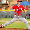 Beck Diefenbach  -  bdiefenbach@daily-chronicle.com<br /> <br /> Liners' pitcher Jon Dicus (7) winds up during the fourth inning of the DeKalb County Liners home opening game at Founder Field at Sycamore Park in Sycamore, Ill., on Wednesday June 16, 2010.