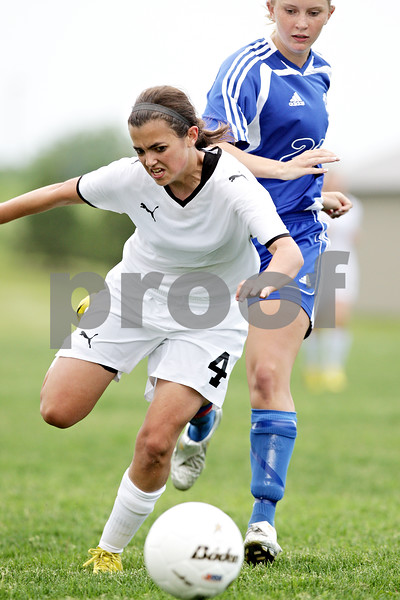 Beck Diefenbach  -  bdiefenbach@daily-chronicle.com<br /> <br /> Sycamore's Jessica Johnson (4, front) falls forward after colliding with Rosary's Carey Deking (29) during the second half of the IHSA Class 2A Hampshire Sectional Semi-final game  at Hampshire High School in Hampshire, Ill., on Tuesday May 25, 2010. Sycamore defeated Rosary 3 to 1.
