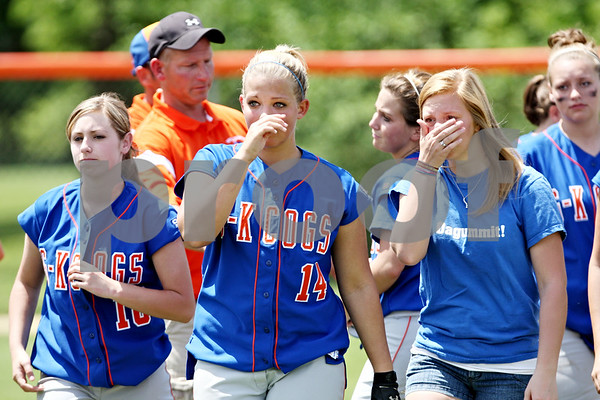 Rob Winner – rwinner@daily-chronicle.com<br /> <br /> The Genoa-Kinstson softball team, including Ashley Miller (left) and Karli Beauchamp leave the field after Stillman Valley defeated the Cogs during the IHSA Class 2A Byron Regional final in Byron, Ill. on Saturday May 22, 2010.