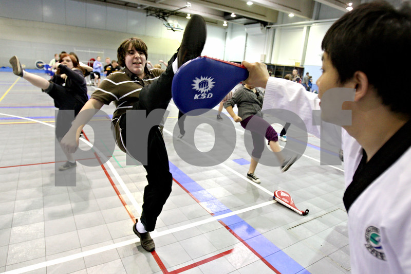 Rob Winner – rwinner@daily-chronicle.com<br /> <br /> Clinton Rosette Middle School student Kevin Becker, 14, performs an axe kick during a physical education incentive field trip at Northern Illinois University on Friday April 16, 2010 in DeKalb, Ill.