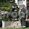 Rob Winner – rwinner@daily-chronicle.com<br /> <br /> While responding to a fire call, DeKalb firefighters carry a pet carrier from a home located on the 1300 block of North Thirteenth Street in DeKalb, Ill. on Thursday April 29, 2010.
