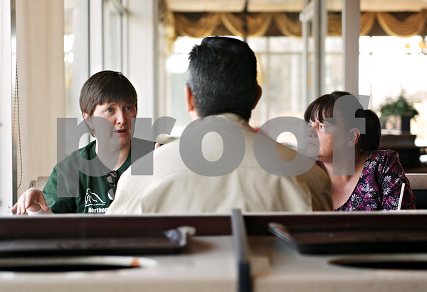 Beck Diefenbach  -  bdiefenbach@daily-chronicle.com<br /> <br /> Richard Salazar (center) speaks with friends Angie Donnelly, left, and Ginger Lange about how they deal with their particular episodes when living with a mental illness over a drink at McDonald's Restaurant in DeKalb, Ill., on Tuesday March 23, 2010.