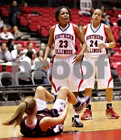 Beck Diefenbach  -  bdiefenbach@daily-chronicle.com<br /> <br /> Northern Illinois' Marke Freeman (23) reacts after she is called for fouling Central Michigan's Stefanie Mauk (on the ground) during the first half of the game at the NIU Convocation Center in DeKalb, Ill., on Wednesday Jan. 20, 2010