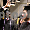 Kyle Bursaw – kbursaw@daily-chronicle.com<br /> <br /> An NIU student waves to the crowd as he enters the floor of the Convocation Center in DeKalb, Ill. on Sunday, Dec. 12, 2010.