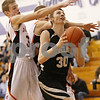 Rob Winner – rwinner@daily-chronicle.com<br /> <br /> Kaneland forward Chaon Denlinger looks to put up a shot in the first quarter of the fifth place game against Sandwich at the Plano Christmas Classic in Plano, Ill. on Thursday, December 30, 2010. Sandwich defeated Kaneland, 42-40.