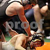 Beck Diefenbach - bdiefenbach@daily-chronicle.com<br /> <br /> Sycamore's Colton Burns (bottom) wrestles against Crystal Lake Central's Trevor Jauch during the 125 weight class match of the IHSA Class 2A dual team state tournament at the U.S. Cellular Coliseum in Bloomington, Ill., on Saturday Feb. 27, 2010.