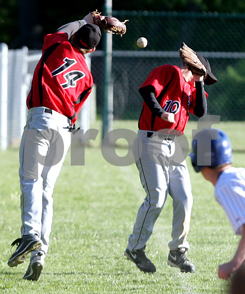 Beck Diefenbach  -  bdiefenbach@daily-chronicle.com<br /> <br /> Indian Creek's Josh Johnson (14, left) and Dane Fleming (10) each miss a fly ball during the bottom of the fifth inning of the game against Hinckley-Big Rock in Big Rock, Ill., on Tuesday April 27, 2010. Indian Creek defeated H-BR 9 to 8.