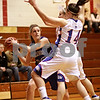Beck Diefenbach – bdiefenbach@daily-chronicle.com<br /> <br /> Westminster's Rachel Doby (20) is surrounded by Hinckley-Big Rock during the first quarter of the IHSA Class 1A Regional playoff game at Indian Creek High School in Shabbona, Ill., on Wednesday Feb. 10, 2010.