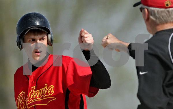 Beck Diefenbach  -  bdiefenbach@daily-chronicle.com<br /> <br /> Batavia's Tim Schofield (4) is congratulated after a hit during the first inning of the game against Sycamore at Sycamore Park in Sycamore, Ill., on Wednesday April 21, 2010. Batavia defeated Sycamore 4 to 2.