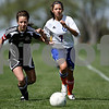 Rob Winner – rwinner@daily-chronicle.com<br /> <br /> Indian Creek's Nina Yegoiants (left) and Genoa-Kingston's Rachael Harris chase after a ball for possession during the first half of their game on Saturday April 17, 2010 in DeKalb, Ill. for Barbfest.
