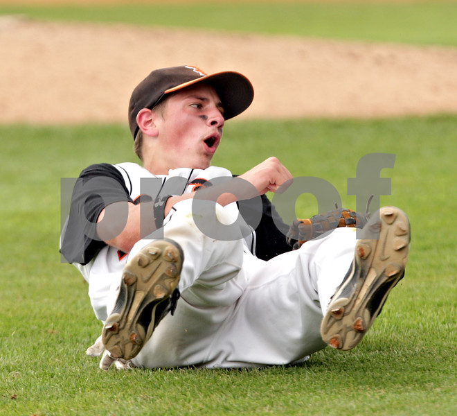 Beck Diefenbach  -  bdiefenbach@daily-chronicle.com<br /> <br /> DeKalb sophomore Tyler Gosnell (17) reacts after diving for a pop fly during the second inning of the IHSA Class 3A State Semifinal Game against Marian Central in Joliet, Ill., on Friday June 11, 2010.