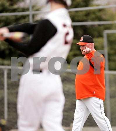 Beck Diefenbach  -  bdiefenbach@daily-chronicle.com<br /> <br /> DeKalb DeKalb head coach Justin Keck  talks to Brian Sisler (22) before Sisler steps into the batter's box during the bottom of the fifth inning of the game against Sandwich at DeKalb High School in DeKalb, Ill., on Wednesday March 24, 2010. DeKalb defeated Sandwich 7 to 1.