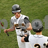 Beck Diefenbach  -  bdiefenbach@daily-chronicle.com<br /> <br /> Sycamore's Eric Ray (5, top) is congratulated after scoring a run during the fifth inning of the game against Indian Creek at Sycamore Park in Sycamore, Ill., on Monday April 19, 2010. Sycamore defeated Indian Creek 10 to 3.
