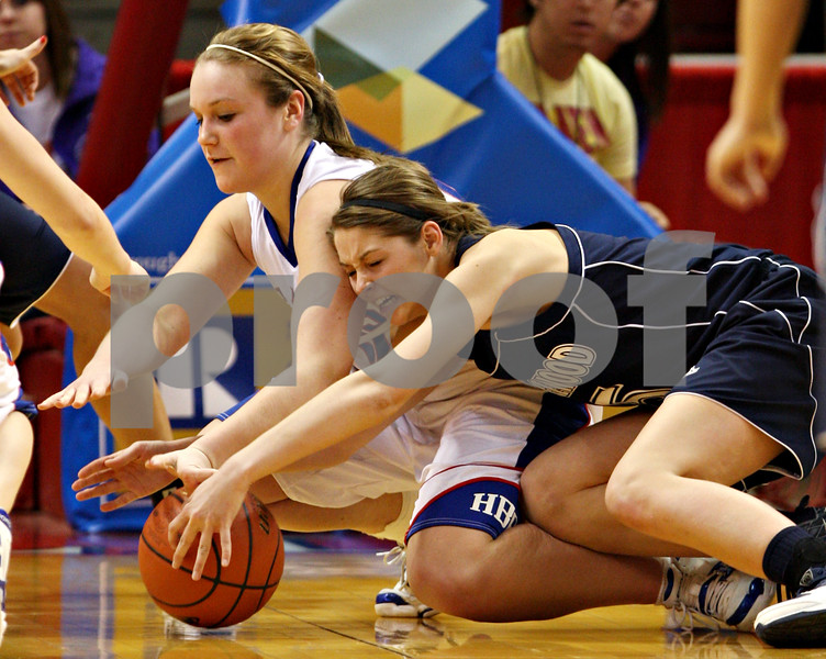 Beck Diefenbach - bdiefenbach@daily-chronicle.com<br /> <br /> Hinckley-Big Rock's Katie Hollis (left) battles Ridgewood's Stephanie Williams during overtime of the IHSA Class 1A semifinal game against Ridgewood at the Red Bird Arena on the campus of Illinois State University in Bloomington, Ill., on Friday Feb. 26, 2010.