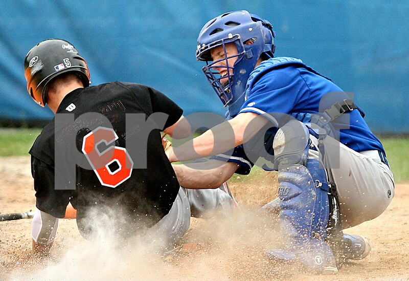 Beck Diefenbach  -  bdiefenbach@daily-chronicle.com<br /> <br /> DeKalb's Kevin Sullivan (6, left) is tagged out by Geneva's catcher during the sixth inning of the game at Geneva High School in Geneva, Ill., on Thursday May 13, 2010. DeKalb defeated Geneva 5 to 3.