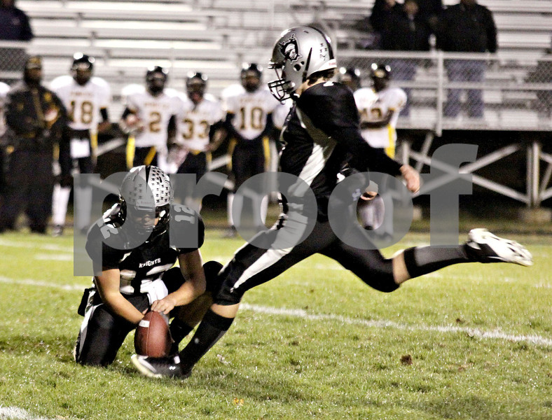 Wendy Kemp - For The Kane County Chronicle<br /> Kaneland's Matt Rodriquez kicks for the extra point during Friday's playoff game against King College Prep.<br /> Maple Park 10/29/10
