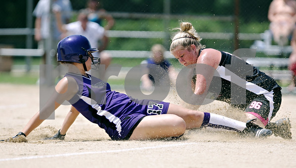 Rob Winner – rwinner@daily-chronicle.com<br /> <br /> Fox Valley Renegades base runner Alex Buhrow (17) slides safely into third base before the tag of Kishwaukee Valley Storm third baseman Kendra Buchholz (96) during their 14U bracket game at the Storm Dayz softball tournament on Saturday June 26, 2010 in Sycamore, Ill.