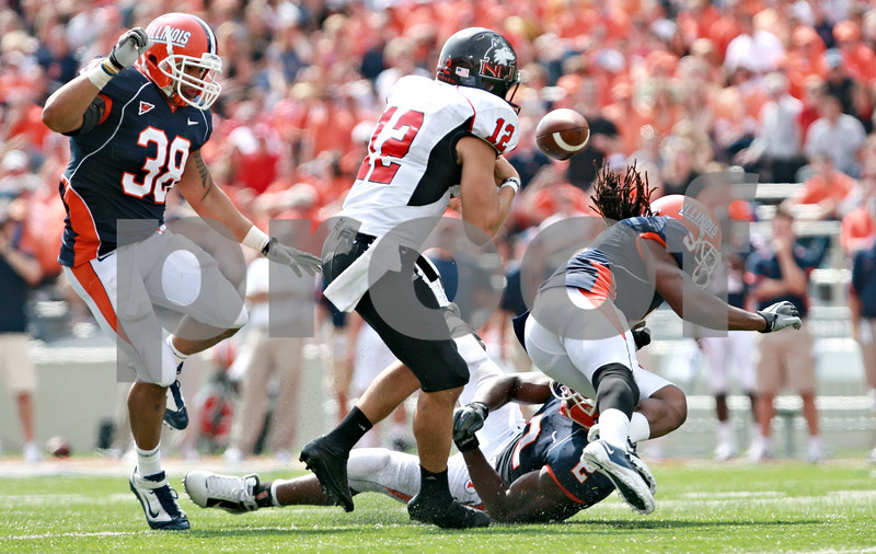 Rob Winner – rwinner@daily-chronicle.com<br /> <br /> Northern Illinois quarterback Chandler Harnish fumbles the football at the start of the fourth quarter in Champaign, Ill.  on Saturday September 18, 2010.
