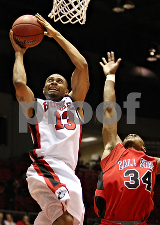 Rob Winner – rwinner@daily-chronicle.com<br /> Xavier Silas, of Northern Illinois, goes to the basket and puts up two as NIU hosted Ball State on Saturday February 13, 2010 in DeKalb, Ill. Ball State defeated NIU, 71-66.