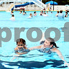 Rob Winner – rwinner@daily-chronicle.com<br /> <br /> Kate Little, of DeKalb, and her daughter Mikaili, 3, swim together in the pool at Hopkins Park in DeKalb, Ill. on Friday June 4, 2010. The two visit the pool every weekend.