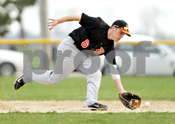 Beck Diefenbach  -  bdiefenbach@daily-chronicle.com<br /> <br /> DeKalb's Kevin Sullivan (6) fields a grounder in the bottom of the third inning of the game against Sycamore at Sycamore Park in Sycamore, Ill., on Tuesday April 6, 2010.