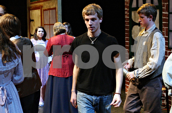 "Rob Winner – rwinner@daily-chronicle.com<br /> <br /> 18-year-old director Joey Gage positions his cast members during rehearsal for ""The Legend of Sleepy Hollow,"" at the Egyptian Theatre in Dekalb, Ill. on Tuesday September 21, 2010."