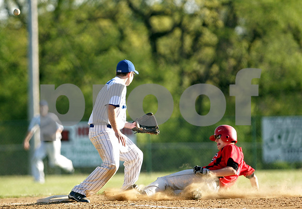 Beck Diefenbach  -  bdiefenbach@daily-chronicle.com<br /> <br /> Indian Creek's Rick Cruise (16, right) slides in safe at third base as Hinckley-Big Rock's Dylan Johnsen (1) misses the ball during the top of the fifth inning of the game in Big Rock, Ill., on Tuesday April 27, 2010. Indian Creek defeated H-BR 9 to 8.